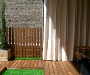 Rideau d'extérieur sur une terrasse rénovée par Exonido